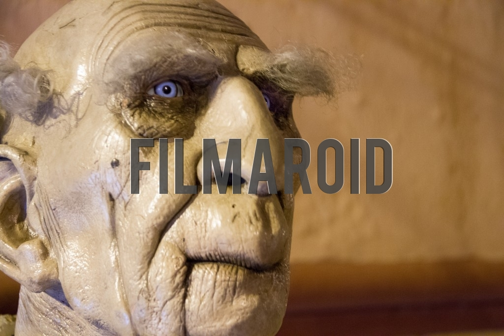 Close up of a halloween statue of a wrinkly and scary old man