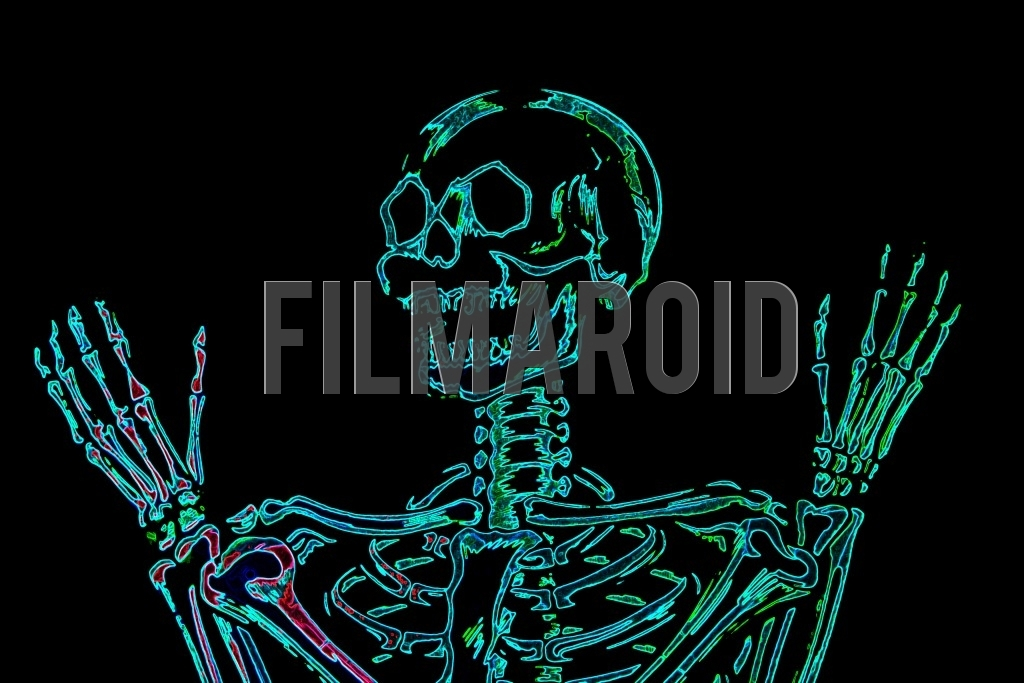 Medium shot of a human skull with expressive hands and a colorful neon effect against a pitch black background