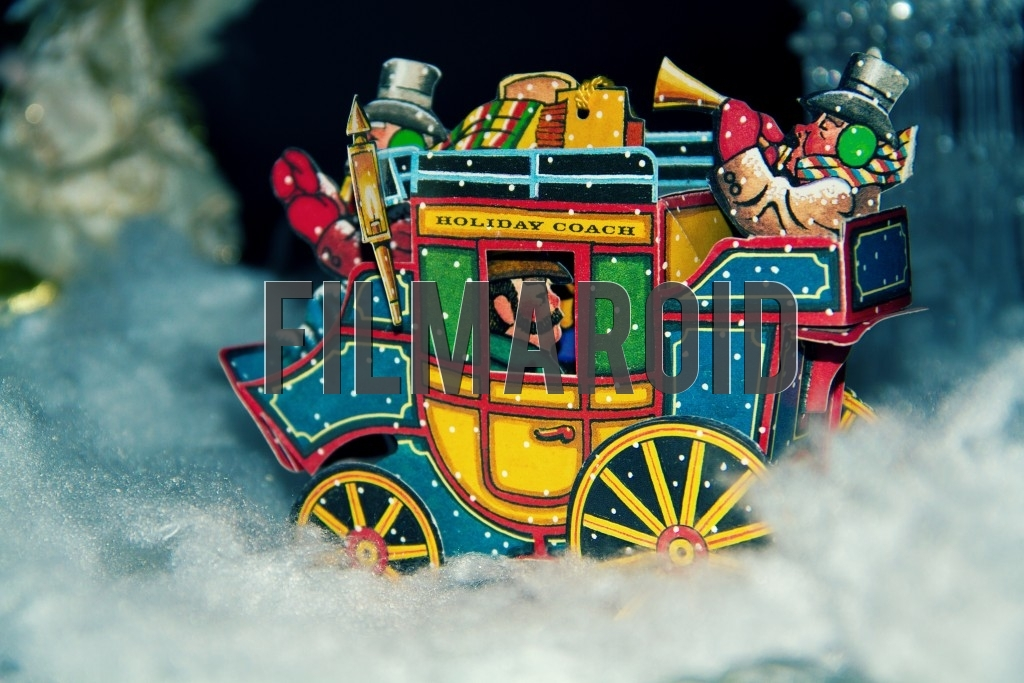 A Christmas Holiday Stage Coach with musicians traveling through a snowy landscape during one winter night