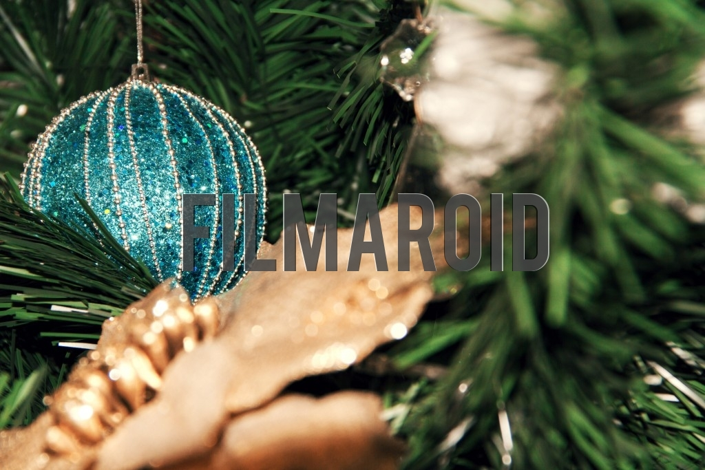 A turquoise Christmas tree ornament decorated with silver details