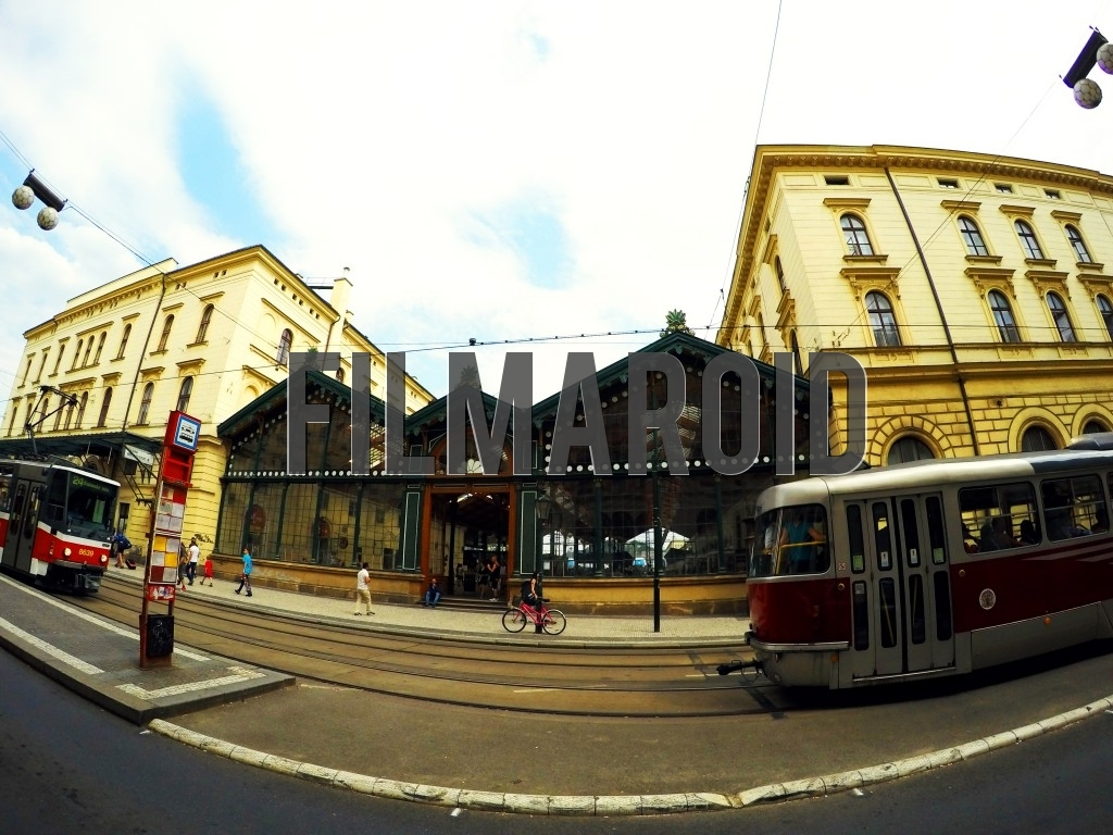 Front view of a European Train Station Masarykovo Nadrazi in Prague with trams passing by
