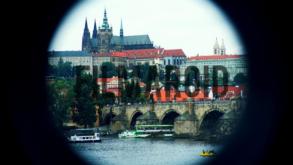 Photo taken through a keyhole of Prague Castle and Charles Bridge