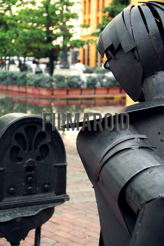 A metal street art sculpture of a man and a vintage radio found in the city of Cartagena Colombia
