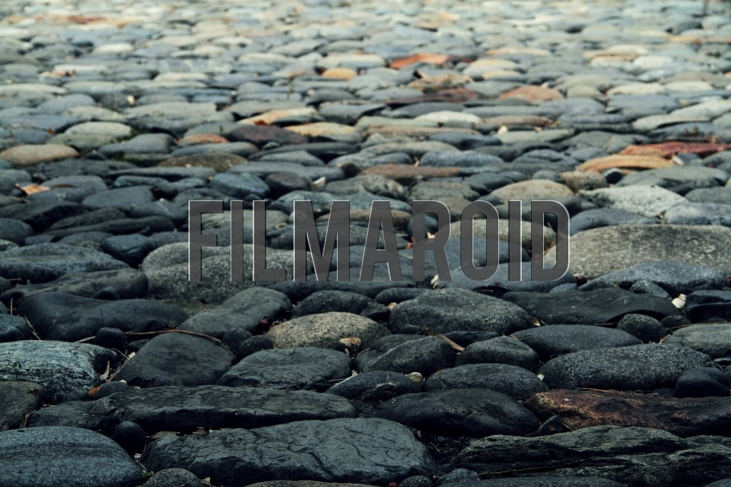 Texture view of an old colonial dark stone street in a Colombian hacienda