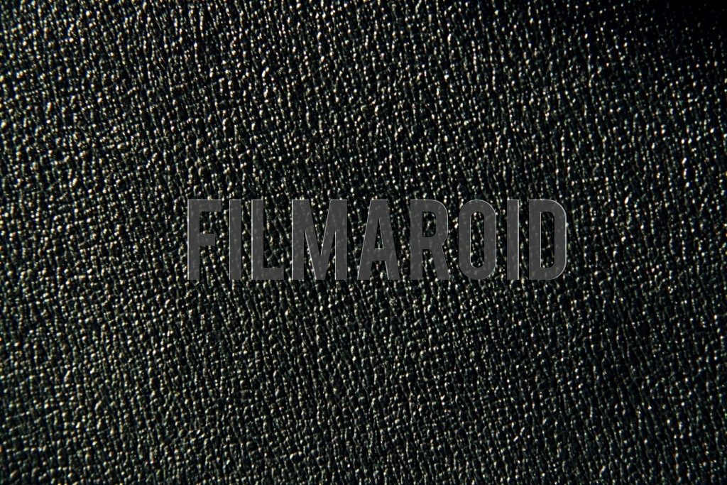 Closeup of faux black leather texture with lots of embossed details