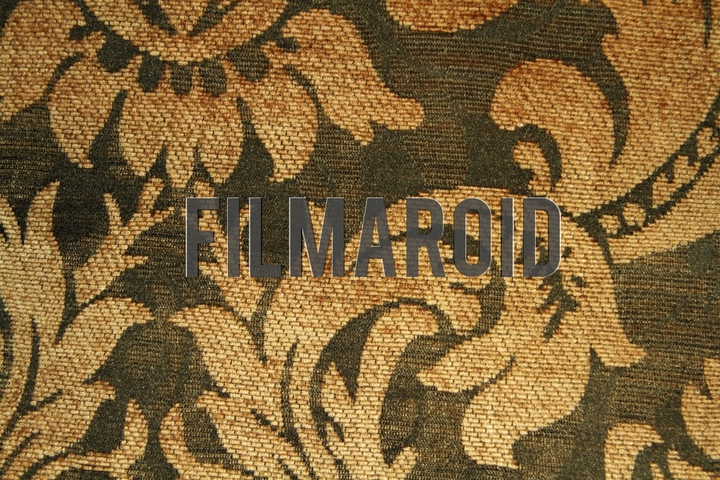 An old Victorian fabric for upholstery with golden flower patterns and green background texture