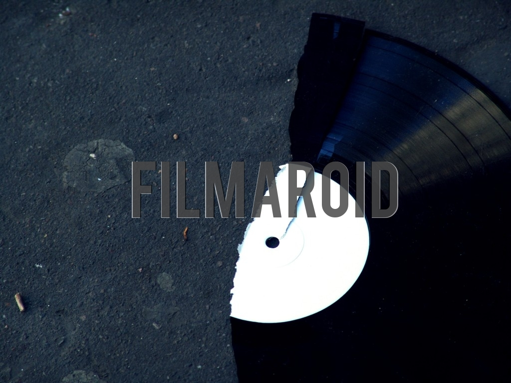 A broken vinyl record lying on street as background