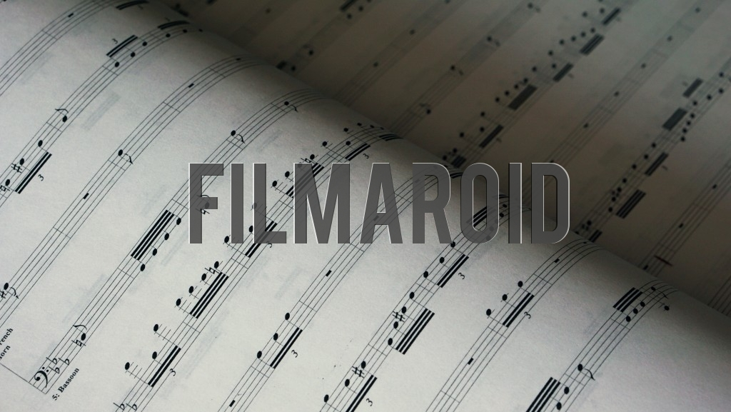 Music notes along with tabs for different instruments and printed on paper as background