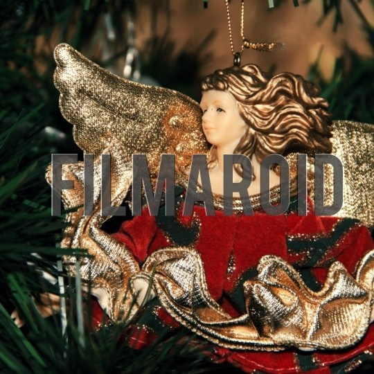 Christmas season red gold angel ornament - A collection of stock photos covering different Holidays