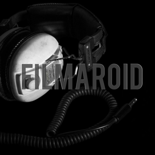 70s vintage headphones and cable black background - A collection of stock photos about Technology