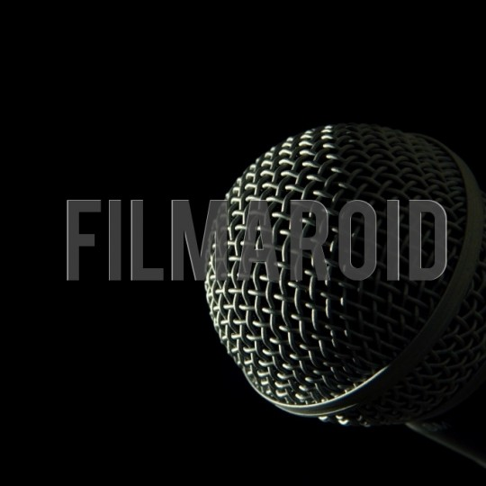 Microphone head against black background - A collection of stock photos about Technology