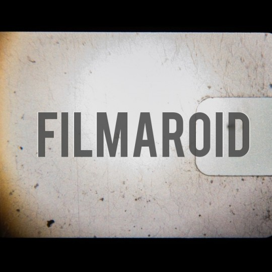 Vintage 8mm film clear frame with dust and specs - A collection of stock photos of Film Grain Scans