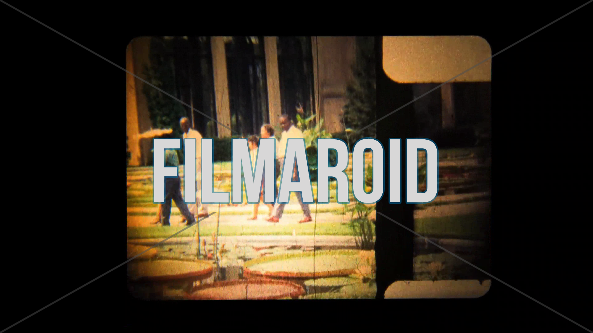 8mm footage of a 60s family walking through beautiful gardens with ponds and water lilies - Vintage 8mm footage of a 60s family walking across the beautiful and vibrant gardens with ponds and water lilies during one summer afternoon